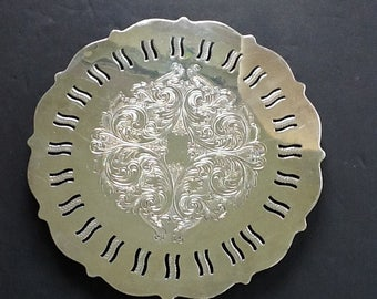Oneida Silverplatead Round Trivet~6 1/2 inches Diameter~4 Ball Feet~Ornate etching in Center~Cut Outs on Outside Edge~Vintage Silverplate~