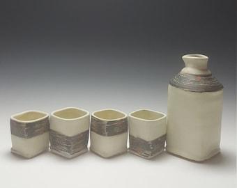 Handmade ceramic sake set by Potteryi. Rustic modern pottery sake set in black and white.
