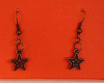 Small star with black outline in Gold, Silver, Bronze and Dark Rose Gold