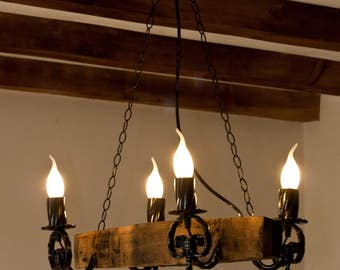 Rustic chandelier.Wine barrel staves and wrought iron with 4 lights
