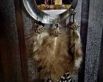 dream-catcher with photo under resin