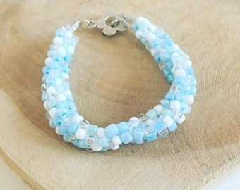 "Kumihimo pearl bracelet ""Coral blue"""