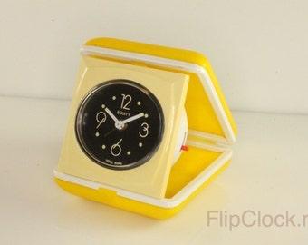 Yellow plastic vintage travel-alarm-clock 'Equity'