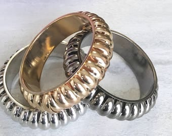 3 pack gold light and dark silver bangles set