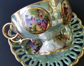 Royal Sealy Tea Cup and Saucer ~ Courting Couple ~ Fragonard Romance ~ Mint Green Lusterware ~ Iridescent