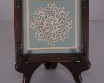 Framed and matted doily, beautiful frame and green matte behind this sweet doily