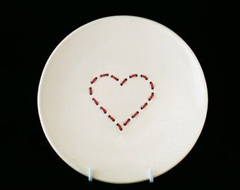 Handmade white ceramic plate with red embroidered heart