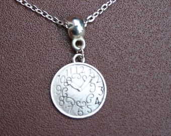 "Silver-plated clock necklace with 8.5"" chain."