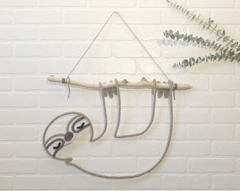 Lazy French knitting hanging from a Driftwood wall decor for nursery or child's room, handmade
