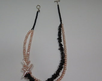 Pearl and black obsidian multilayer off center necklace