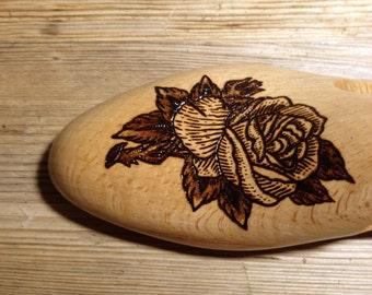 Pyrography traditional rose tattoo flash on wooden vintage shoekeeper