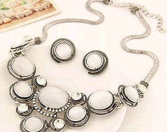 White and silver earring and necklace set