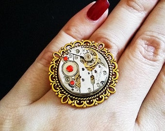 Steampunk ring with watch movement and rhinestones