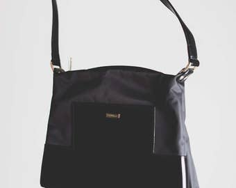Fiorelli Black Leather and Synthetic handbag // Minimal geometric leather detail on front // Metal and leather handle // retro