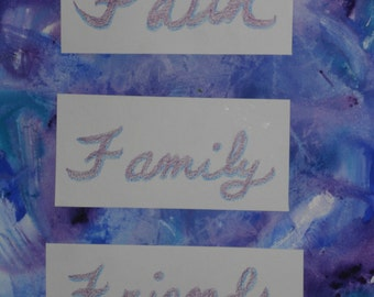 Art work collage saying Faith Family Friends in purple and blue