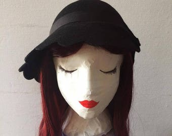 Hat cloche asymmetric roaring twenties-inspired woman