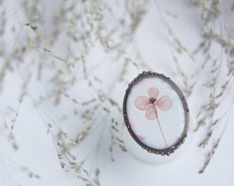 Brooch with small poppy