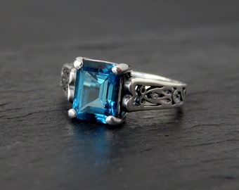 London Blue Topaz Ring: Sterling Silver, size 5.5, dark blue gemstone, December birthstone, 8x6mm rectangle, step cut octagon stone, navy