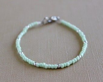 Mint seed bead bracelet with silver speckles.
