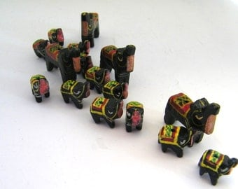 16 wooden elephant  beads -4 large, 12 small