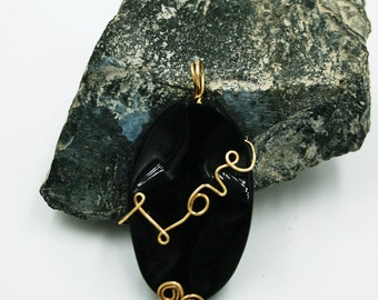 LOVE in Gold and Black - a wire wrapped pendant