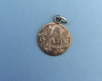 Antique love token with initials FWC