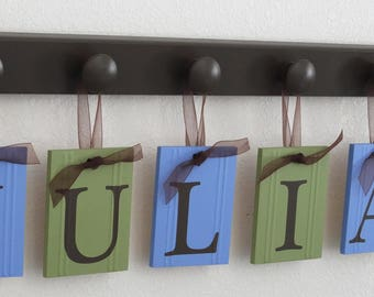 Personalized Gift Wall Name Signs Includes Chocolate Brown Wood Peg and Light Blue and Light Green Tiles with Brown Letter Text and Ribbons