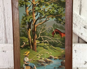 Vintage paint by number painting in frame boy fishing covered bridge