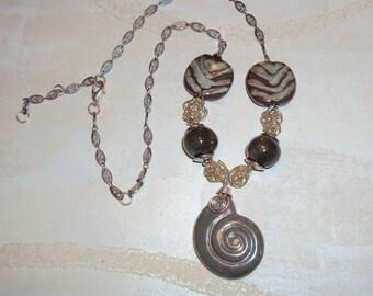 Kazuri Bead Necklace with Fair Trade Clay Beads from Kenya Sandbar Green Sea Shell Pendant Jazzy Pita Pats and Handmade Silver Beads