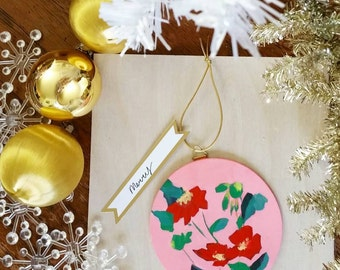 handpainted flowers on a wooden ornament for christmas or holiday decor