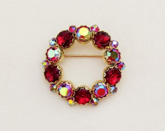 Vintage Weiss circle pin with red molded glass stones and AB rhinestones