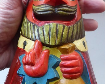 Strange Crudely Decorated Vintage Bank or Money Box which is in the shape of a King - holding his money bag