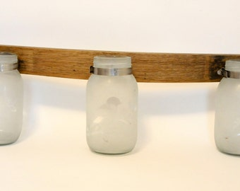 Three bird jars on repurposed wine barrel stave