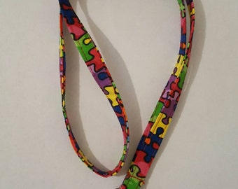 Autism lanyard with puzzle pieces