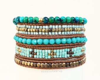 Green blue beaded wrap bracelet with glass beads, gold plated beads, crystal, stone on brown leather cord