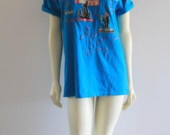 90's Vintage Coyote Pueblo Southwest Cut-Out Glitter Paint Electric Blue Oversize Sedona Mom Shirt