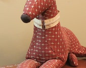 Meet Merry! Merry is a one-of-a-kind, almost life size, recling soft sculpture greyhound.