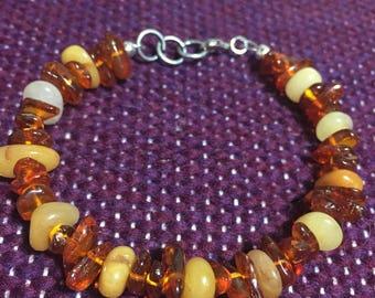 Amber and red Aventurine stone beaded bracelet. 7 inch