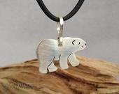 Fine silver Polar bear pendant with sterling silver bail . Hand cut and carved pure silver polar bear necklace . Cute polar bear