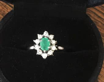 A 18k Gold Emerald and Diamond Ring