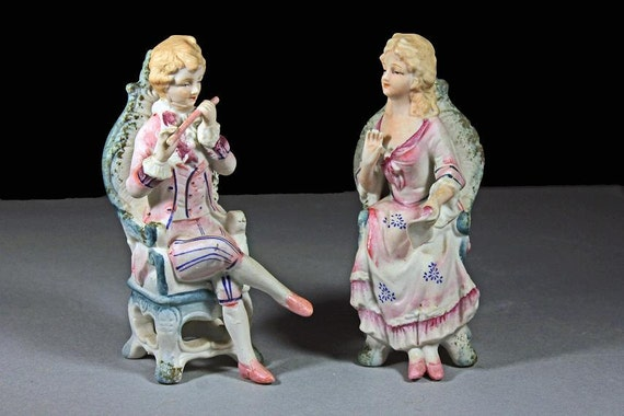 Lipper and Mann Figurines, Set of 2, Colonial Era, Man and Woman, Bisque Porcelain, Man and Flute, Woman and Scroll, Sitting Figurines