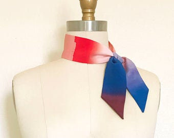 Ombre kerchief in in orange-red, peach, blue & wine is made of pure silk. Tie it on your handbag, in a top-knot headband, or on your wrist.