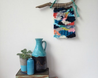 Multi coloured textured woven wall hanging
