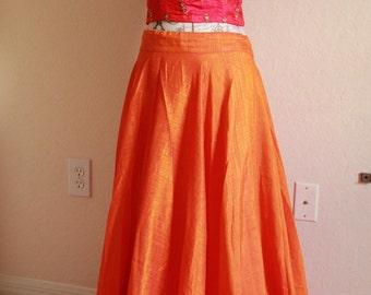 A Orange Lehanga with Pink Crop Top .