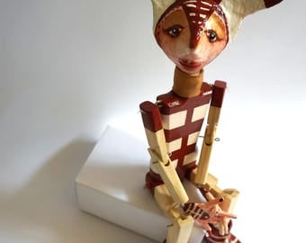Articulated doll, puppet of wood and paper mache Selknam