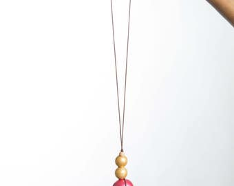 Pink and gold wood bead necklace