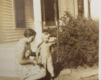 Woman Riding Tricycle with Child Nearby-Farmhouse Porch-1930s- Black and White Snapshot-Antique Vintage Photograph