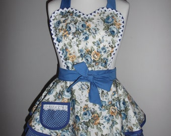 1950s style retro apron pinny in vintage style floral print and blue polka dot fabric.
