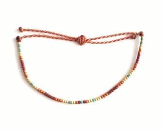 Sunflower Seed Beaded Bracelet on Rust Waxed Polyester Cord, seed bead, waterproof, adjustable