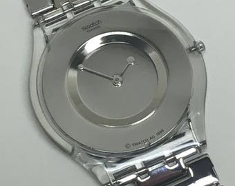 Women's Skin Swatch Watch Paved In Silver SFK103 Near Mint Condition Thin